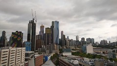 Melbourne's skyline on a cloudy evening