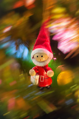 Zooming into New Year (Katrina Wright) Tags: dsc3051edit christmas newyear decoration christmastree colours light blur whoosh speed movement macro santa elf redsuit