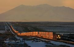 GLOWING MEET, W. WINSLOW, AZ. 2-23-19 (TRAINFLAMES) Tags: bnsf ge dash944cw intermodaltrain stacktrain train railroad sanfranciscopeaks sunset glow i40 seligmansub winslow arizona