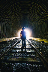 A Boy and His Tunnel (Thomas Hawk) Tags: america california eastbay jackson jacksonpeterson pointrichmond richmond usa unitedstates unitedstatesofamerica silhoutte traintracks traintunnel tunnel fav10 fav25 fav50 fav100