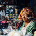 Old Burmese Woman With Scales in Market, Chauk Myanmar