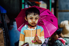 Burmese Child Wearing Thanakha With Umbrella, Chauk Myanmar (AdamCohn) Tags: adam cohn burma chauk myanmar child market portrait streetphotographer streetphotography thanaka thanakha umbrella wwwadamcohncom adamcohn explore explored inexplore