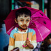 Burmese Child Wearing Thanakha With Umbrella, Chauk Myanmar