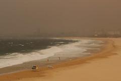 New Years Eve with bush fire smoke (RossCunningham183) Tags: wollongong nsw australia southbeach smoke portkemblasteelworks beach bushfire lifesavers flags beachpatrol visibility
