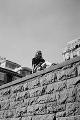 Perched (8200tyler) Tags: bw portrait editorial mamiya 645 120mm film kodak tmax 400 city scape street girl pose