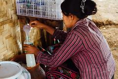 Pouring Htan Yay (ထန်းရည်) Palm Wine, Meikitla Myanmar (AdamCohn) Tags: adam cohn burma htanyay meikitla myanmar alcohol palmtoddy palmwine streetphotographer streetphotography toddy woman wwwadamcohncom ထန်းရည် adamcohn ngc ngg