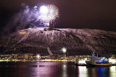 A7305264 (Daniel John Benton) Tags: tromsø tromso tromsøya tromsoya tromsøysundet tromsoysundet tromsoysund tromsøysund tromsdalen troms nordnorge northernnorway norge norway scandinavia europe arctic night fireworks snow snø hill mountain citylights nightlights sea boat boats ship ships sony a7iii a7 ig20