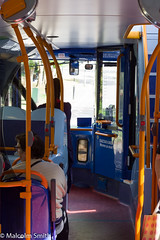 Another Ride On Route 215 (M C Smith) Tags: bus route 215 pentax kp inside people passengers women light shadows orange stairs downstairs mirrors sitting letters numbers symbols poles reflections white black