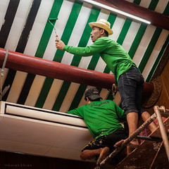 Chinese temples are touched up for Chinese New Year in January 2020 (Goran Bangkok) Tags: chinatown bangkok thailand men persons painting painter temple chinese chinesenewyear green hat happyplanet asiafavorites