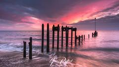 Bawdsey Sunrise (Aron Radford Photography) Tags: yellow bawdsey suffolk quay manor landscape east anglia sunrise dawn posts beach shingle sea water defences jetty pld
