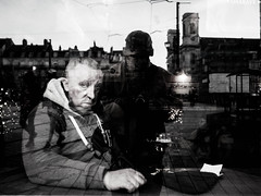 Melting all together (Aurélien B.) Tags: alone blackandwhite monochrome streetphotography france people man drink white black reflection town cathedral bar