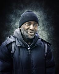 Rod (mckenziemedia) Tags: man portrait portraiture face smile stockingcap people humanity chicago city urban street streetphotography coat homeless homelessness