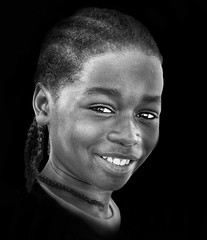 More smiles and innocence for us all ... (daystar297) Tags: streetportrait portrait black africanamerican kid boy beautiful face sweet smile braids nikon newyearsday blackandwhite bnw bw monochrome