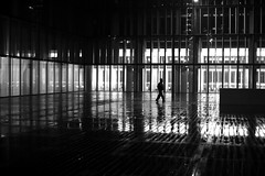 Crossing the illuminated place (pascalcolin1) Tags: paris13 femme woman pluie rain reflets reflection nuit night photoderue streetview urbanarte noiretblanc blackandwhite photopascalcolin 50mm canon50mm canon