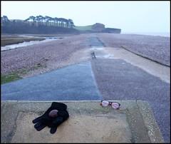 gloves, glasses and wet stone (Philip Watson) Tags: budleighsalterton eastdevon devon seaside beach lostproperty