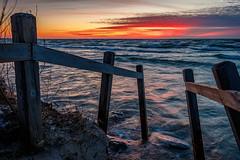 Resolution (Bert CR) Tags: sunset lakehuron greatlakes colorfulsunset resolution newyearsresolution erosion cordonedoff saublebeach barrier highwaterlevels first