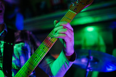 Guitarist Performing Live. Arm on guitar neck closeup (shixart1985) Tags: telecaster fender fingers closeup night club concert guitarist musician rock singer band dark advertisement arms authentic backdrop background banner chord close electric guitar finger fingertip flyer hands macro motion musical natural nightclub play poster real shop show store tab unrecognizable wooden