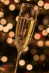 New Year Bubbles (Rebecca Leyva) Tags: new white holiday glass gold lights bokeh toast year flute sparkle newyears champaign celebrate bubbly cheers first festive