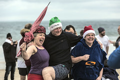 New Year's Day Swim (Frank Fullard) Tags: frankfullard fullard candid street portrait fun frolics trio santa hat umbrella swim newyear newyearsday charity kneesup whiskey soup cold hot water atlantic ocean lifeboat rnli cap achill mayo irish ireland color colour