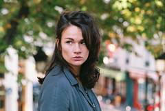 Cécile. (Nicolas Fourny photographie) Tags: canon eos3 35mm 85mm model beauty portrait portraiture womanportrait girlportrait bokeh dof depthoffield autumn fall paris street naturallight film filmisnotdead analogcamera analogphotography agfa vista200 trees greeneyes