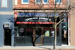 Jimmy John's - Rockford, Illinois (Cragin Spring) Tags: illinois il midwest rockford rockfordillinois rockfordil sign unitedstates usa unitedstatesofamerica restaurant jimmyjohns fastfood chain sandwich sandwiches neon downtown downtownrockford window