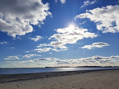morning sunshine on Revere Beach (angelinas) Tags: massachussettes revere beach sky clouds sun sunlight reflection water ocean usa usalandscapes northamerica newe newengland plages beaches calm landscapes seascpapes seashore