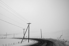Drifting (amatecha) Tags: winter britishcolumbia snow ice cold bw powerlines road pavement landscape contrast greyscale sky white blackandwhite