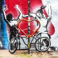 Heart Attack (DobingDesign) Tags: street heart bike figures streetart streetphotography london heartshape bikerack streetfurniture wheels shape locked twisted inthemiddle relationships passion passionate fightforlove fight violence attack red love loveandhate
