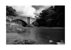 Norbury bridge (G. Postlethwaite esq.) Tags: bw derbyshire norbury sonya7mkii staffordshire blackandwhite bridge clouds layerstack monochrome photoborder river riverdove sky trees water