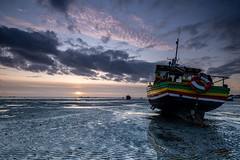 Sun Down. (daveknight1946) Tags: essex thorpebay fishingboat jamaicadawnstar riverthames clouds mud sunset