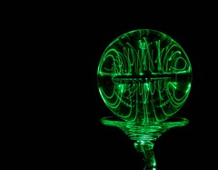 Green Glow (Karen_Chappell) Tags: green ball refraction glass circle round orb sphere black abstract led glow lightpainting longexposure stilllife color colour