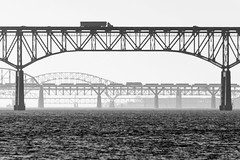 19-9138bw (George Hamlin) Tags: maryland perryville railroad freight train intermodal csx q031 dpu distributed power unit diesel locomotive susquehanna river bridges i95 silhouette water containers sky truck photodecor george hamlin photography