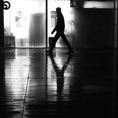 The rhombus (pascalcolin1) Tags: paris13 homme man lumière light pluie rain reflet reflection nuit night fenêtre window losange rhombus photoderue streetview urbanarte noiretblanc blackandwhite photopascalcolin 50mm canon50mm canon