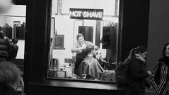 Hot Shave (byronv2) Tags: blackandwhite blackwhite bw monochrome street candid peoplewatching edinburgh edimbourg scotland night nuit edinburghbynight dusk hotshave barber barbershop haircut hair hairdresser window seat seated forrestrow