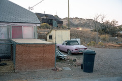 (patrickjoust) Tags: fujica gw690 kodak portra 160 120 6x9 medium format c41 color negative film 90mm f35 fujinon lens rangefinder manual focus analog mechanical patrick joust patrickjoust west western us usa united states north america estados unidos tonopah nevada nv desert mining town pink car house home early morning dawn tripod window illuminated hotel sign