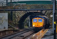 Brightening Up A Dull Day (whosoever2) Tags: uk united kingdom gb great britain england nikon d7100 train railway railroad november 2019 leagreen station liverpool gbrf class66 66778 drax 4m12 rain stone arch bridge