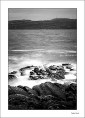 The Quiet Sea - (Jupiter 9, 85mm, f11) - 2019-12-27th (colin.mair) Tags: 85mm bw black jupiter9 lens littlecumbrae m42 manual nd6 portencross rocks russian ussr white border f11 filter frame monochrome sea surf