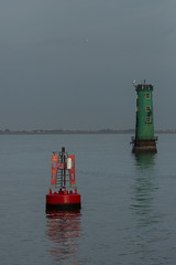 colours reflected at the mouth of the Liffey (Wendy:) Tags: colours red green reflections lighthouse buoy