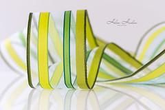 Ribbon (hehaden) Tags: ribbon striped coiled green yellow reflection macro lookingcloseonfriday ribbons sel90m28g