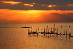 Lake Biwa at sunset (Teruhide Tomori) Tags: lakebiwa shiga kohoku landscape winter lake japan japon water afternoon evening nature 琵琶湖 湖北 日本 関西 滋賀県 自然 風景 夕景 sky sunset