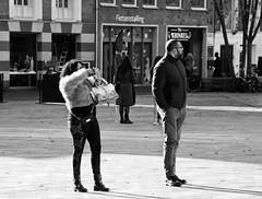 Not my Business (Hindrik S) Tags: streetphoto strjitfotografy strasenfotografie straatfotografie street strase straat strjitte candid people minsken mensen peuple leute menschen mens blackandwhite bw zwartwit swartwyt girl man frou vrouw frau femme lady mann homme smartphone snoadfoan photographer photo streetphotography strasse liwwadden leeuwarden ljouwert sonyphotographing sony sonyalpha amount minoltaamount tamron tamronaf16300mmf3563dillvcpzdmacrob016 2019