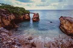 Natural Bridge (GOJR.) Tags: ocean travel color film beach nature analog seascapes slide fujifilm velvia100 expiredfilm nikonf4s nikkor20mmf35ais gndfilter06 slidefilm emulsion positivefilm vintagecamera