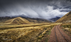 Around the corner (marko.erman) Tags: peru perurail train andes abralaraya pass southamerica latinamerica highaltitude wideangle sony mountains tracks dramaticsky grass grassland outside outdoor travel