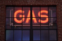Gas behind Glass (slammerking) Tags: gas neon neonsign window brick brickwall