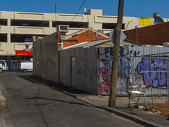 Footscray, Melbourne, Victoria, Australia. 2014-03-14 14:25:40 (s2art) Tags: footscray melbourne victoria australia footscraypc3011 pc3011 lines line shadwo shadow auspctaggedpc3011 laneway outdoor outdoors shopping shops market bluesky grafitti tinshed tinsheds shoppingtrolley carpark street urban newtopographics urbanphotography colourcontrasts 2014 history archives angles bitumen road footpath
