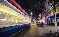 A tram zooms by on Bahnhofstrasse (PeterThoeny) Tags: zurich switzerland bahnhofstrasse city christmaslight christmasdecoration light decoration lucie night outdoor tram train blur motionblur sony sonya6000 a6000 selp1650 1xp raw photomatix hdr qualityhdr qualityhdrphotography fav200
