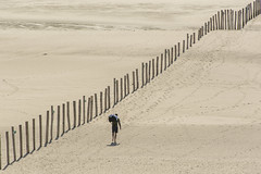 Lonely (Jan van der Wolf) Tags: map200172v diagonal diagonaal poles palen zand sand beach strand man people candid lonely