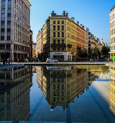 Lookback in Lyon (Peter Leigh50) Tags: lyon french france town city cityscape building people summer sunshine shadows reflection water pool sky lines