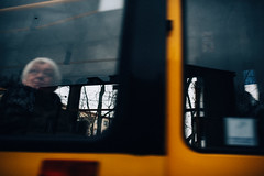 For a fleeting moment... (ewitsoe) Tags: 2020 interior moments nikon street warszawa winter erikwitsoe everydaylife poland warsaw woman tram life passing blur bokeh motion citylife olderwoman lady face looking