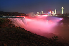 Over the falls (Notkalvin) Tags: niagarafalls niagarariver niagara newyork water waterfall falls night lights lit pink susangkomen breastcancerawareness outdoors highbanks erosion tourism touristattraction internationalborder famousplace longexposure mikekline notkalvinphotography mist power evening landscape